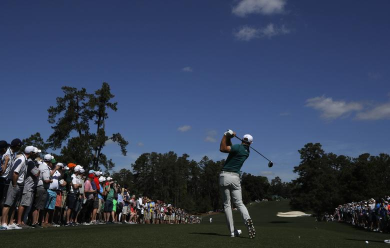 Dustin Johnson of the U.S. hits off the eighth tee during Tuesday practice rounds for the 2017 Masters at Augusta National Golf Course in Augusta, Georgia, U.S., April 4, 2017. REUTERS/Lucy Nicholson