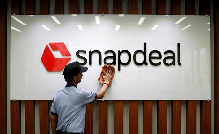 An employee cleans a Snapdeal logo at its headquarters in Gurugram on the outskirts of New Delhi, India, April 3, 2017.   Picture taken April 3. REUTERS/Adnan Abidi