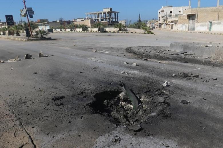 A crater is seen at the site of an airstrike, after what rescue workers described as a suspected gas attack in the town of Khan Sheikhoun in rebel-held Idlib, Syria April 4, 2017. REUTERS/Ammar Abdullah