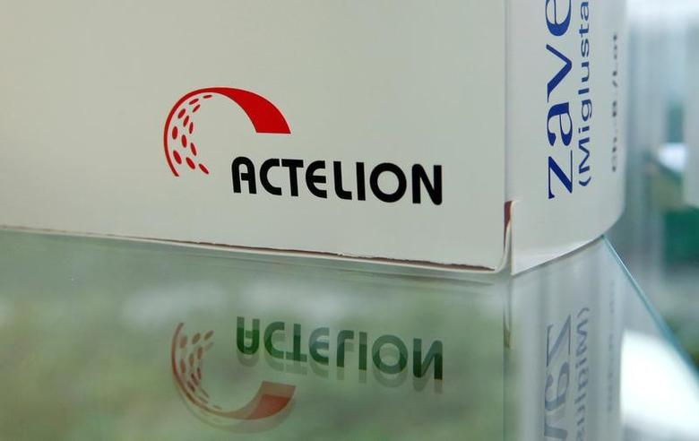Swiss biotech company Actelion's logo is seen on a dummy package of medication displayed at the company's headquarters in Allschwil, Switzerland January 26, 2017. REUTERS/Arnd Wiegmann