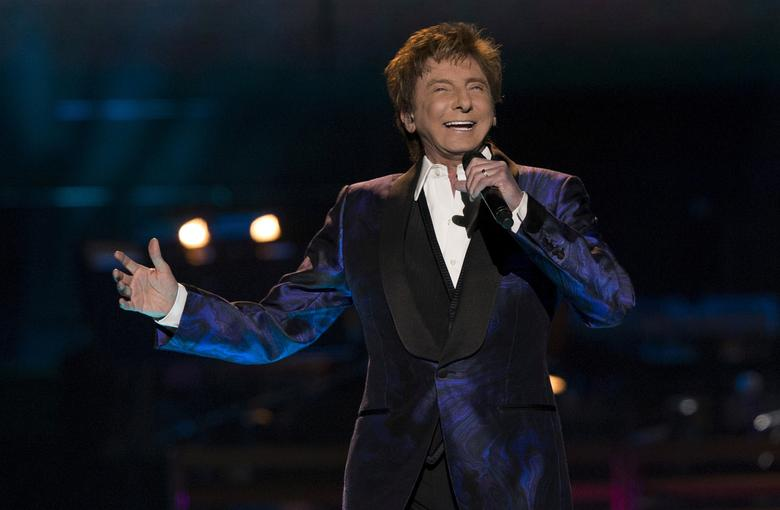 FILE PHOTO: Recording artist Barry Manilow performs during his ''One Last Time! Tour'' at Staples Center in Los Angeles, California April 14, 2015.  REUTERS/Mario Anzuoni/File Photo