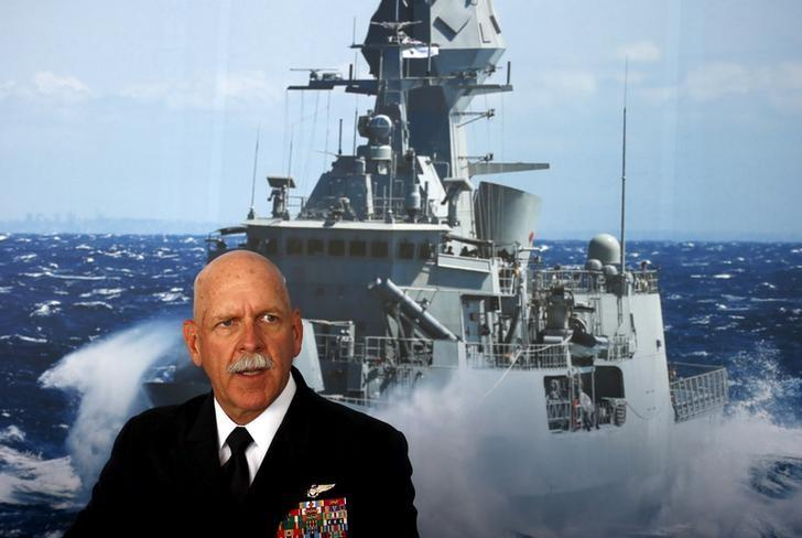 FILE PHOTO: Commander of the U.S. Pacific Fleet Admiral Scott Swift sits in front of a large poster of an Australian Navy frigate as he speaks during a media conference at the 2015 Pacific International Maratime Exposition in Sydney, Australia, October 6, 2015.    REUTERS/David Gray/File Photo