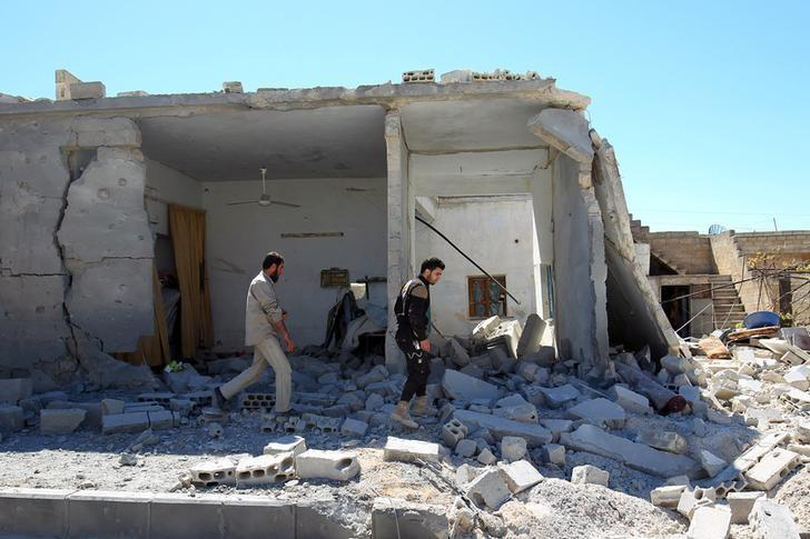 Civil defense members inspect the damage at a site hit by airstrikes on Tuesday, in the town of Khan Sheikhoun in rebel-held Idlib, Syria April 5, 2017. REUTERS/Ammar Abdullah