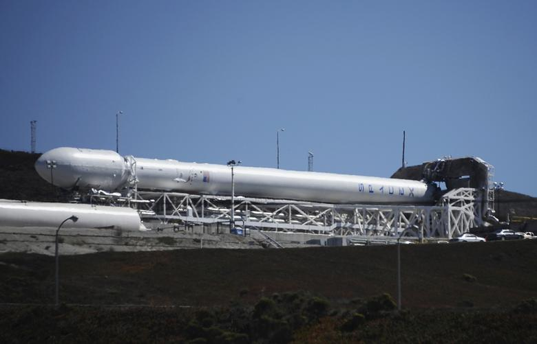 A SpaceX upgraded Falcon 9 rocket undergoes launch preparations at Vandenberg Air Force Base in California September 27, 2013. REUTERS/Gene Blevins