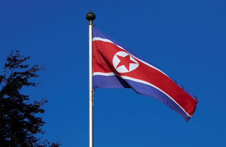 FILE PHOTO - A North Korean flag flies on a mast at the Permanent Mission of North Korea in Geneva October 2, 2014. REUTERS/Denis Balibouse/File Photo