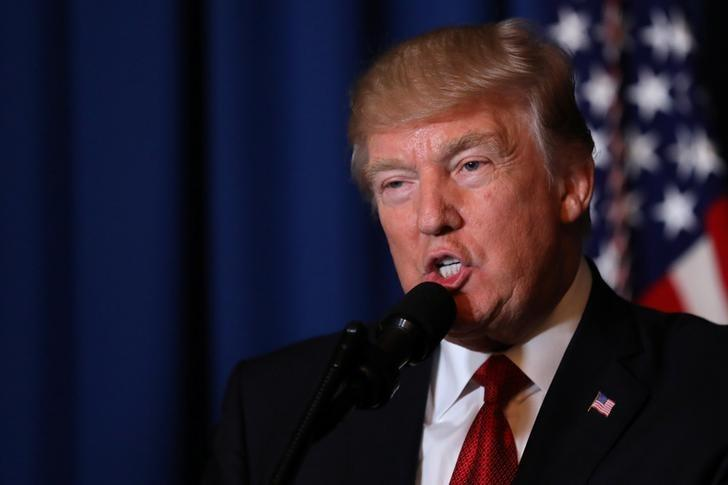U.S. President Donald Trump delivers a statement about missile strikes on a Syrian airbase at his Mar-a-Lago estate in West Palm Beach, Florida, U.S., April 6, 2017. REUTERS/Carlos Barria