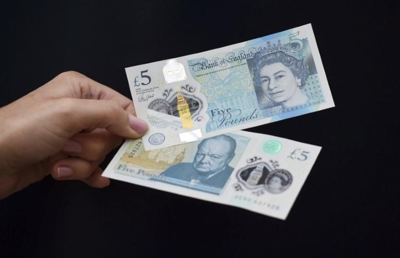 The new polymer 5 pound Sterling note featuring Sir Winston Churchill, is unveiled at Blenheim Palace in Oxfordshire, Britain June 2, 2016. REUTERS/Joe Giddens/Pool