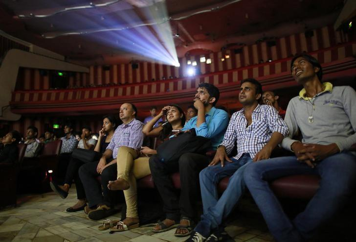 REPRESENTATIVE IMAGE -- Cinema goers watch Bollywood movie ''Dilwale Dulhania Le Jayenge'' (The Big Hearted Will Take the Bride), starring actor Shah Rukh Khan, inside Maratha Mandir theatre in Mumbai December 12, 2014.  REUTERS/Danish Siddiqui/File Photo