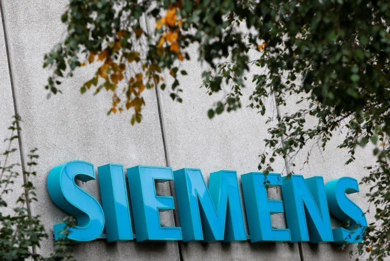 FILE PHOTO: Siemens logo is pictured at Siemens Healthineers headquarters in Erlangen near Nuremberg, Germany, October 7, 2016. REUTERS/Michaela Rehle