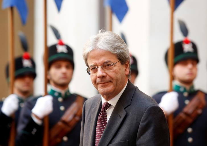FILE PHOTO - Italian Prime Minister Paolo Gentiloni looks on as he waits for the arrival of Britain's Prince Charles at Chigi Palace in Rome, Italy, April 5, 2017. REUTERS/Remo Casilli/File Photo