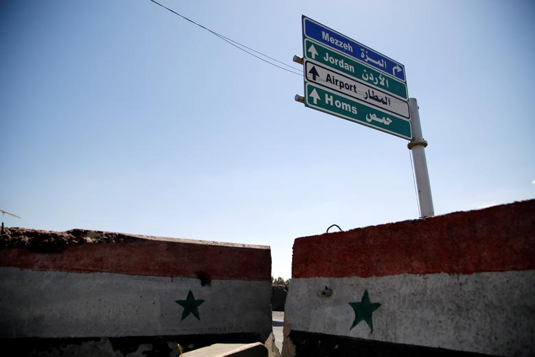 A road sign that shows the direction to Homs is seen in Damascus, Syria April 7, 2017. REUTERS/Omar Sanadiki