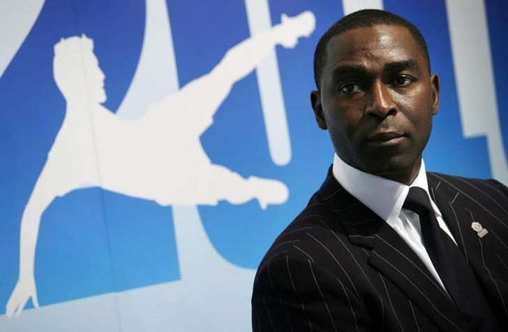 Former Manchester United striker Andy Cole attends a news conference in Hong Kong April 13, 2010. Cole will captain an international team in the Hong Kong Sevens Soccer tournament which will run from May 14 to 16.    REUTERS/Bobby Yip/File Photo