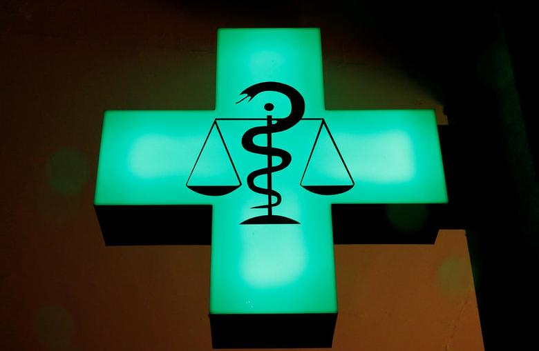 FILE PHOTO: The Rod of Asclepius symbol is seen in front of a pharmacy in Zurich, Switzerland, November 10, 2016.    REUTERS/Arnd Wiegmann/File Photo