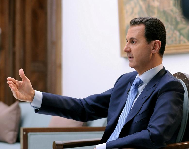FILE PHOTO: Syria's President Bashar al-Assad speaks during an interview with Croatian newspaper Vecernji List in Damascus, Syria, in this handout picture provided by SANA on April 6, 2017. SANA/Handout via REUTERS/File Photo