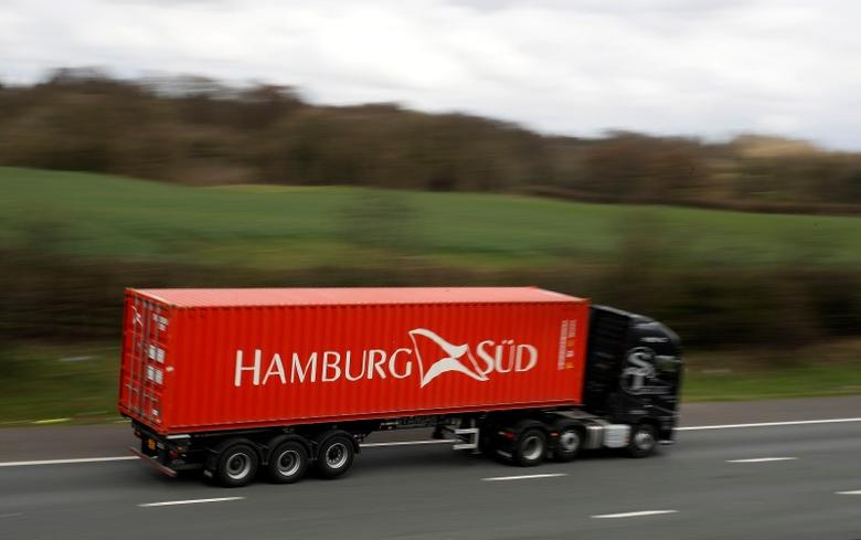 A lorry transports a Hamburg Sud shipping container along the M6 motorway near Knutsford, northern England, April 8, 2016. REUTERS/Phil Noble
