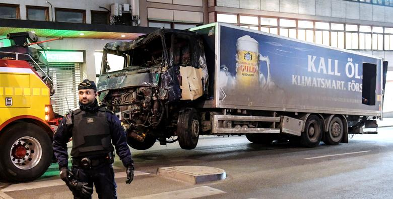 Tow trucks pull away the beer truck that crashed into the department store Ahlens after plowing down the Drottninggatan Street in central Stockholm, Sweden, April 8, 2017. Maja Suslin/TT News Agency/via Reuters