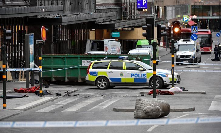 A turned over 'Stockholmslejon', a concrete traffic stopper, is seen outside the roped off area next to the department store Ahlens after a suspected terror attack on the Drottninggatan Street in central Stockholm, Sweden, April 8, 2017. Jonas Ekstromer/TT News Agency/via Reuters     ATTENTION EDITORS - THIS IMAGE WAS PROVIDED BY A THIRD PARTY. FOR EDITORIAL USE ONLY. NOT FOR SALE FOR MARKETING OR ADVERTISING CAMPAIGNS. THIS PICTURE IS DISTRIBUTED EXACTLY AS RECEIVED BY REUTERS, AS A SERVICE TO CLIENTS. SWEDEN OUT. NO COMMERCIAL OR EDITORIAL SALES IN SWEDEN. NO COMMERCIAL SALES.