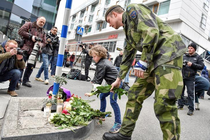 STOCKHOLM 2017-04-08 People laying flowers near the crime scene in central Stockholm the morning after a hijacked beer truck plowed into pedestrians on Drottninggatan and crashed into Ahlens department store on Friday, killing four people, injuring 15 others. TT News Agency/Jonas Ekstromer/via REUTERS