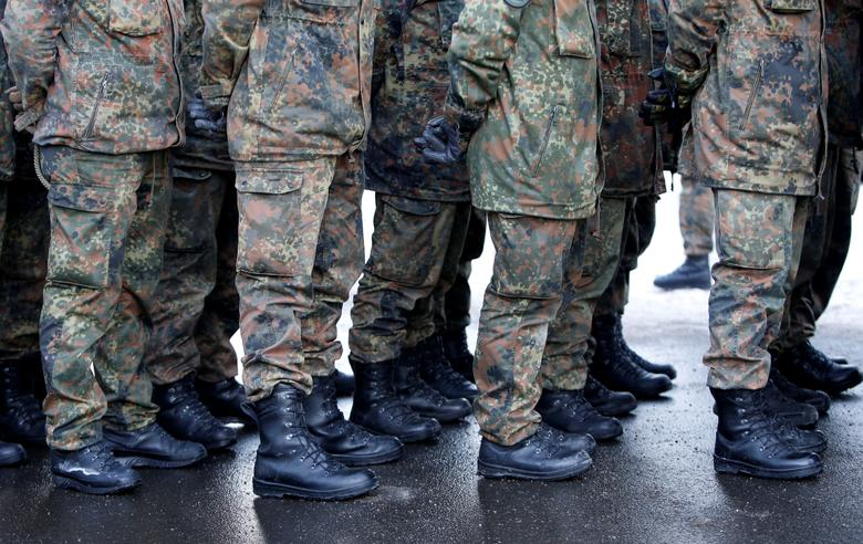 FILE PHOTO: Soldiers of the German armed forces Bundeswehr take part in farewell ceremony for Panzergrenadierbataillon 122, deployment in Lithuania, in Oberviechtach, Germany January 19, 2017.  REUTERS/Michaela Rehle/File Photo