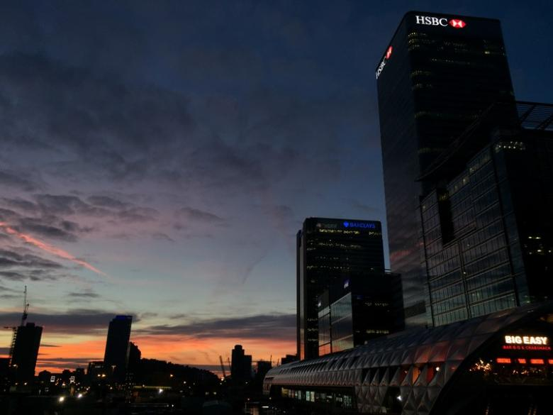 The dawn light is seen over London's Canary Wharf financial district March 30, 2017 the day after Britain's Prime Minister Theresa May invoked Article 50 to trigger Britain leaving the EU. REUTERS/Russell Boyce