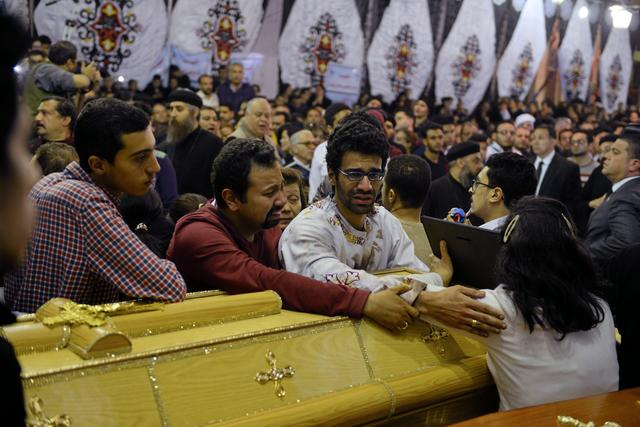 Relatives of victims react next to coffins arriving to the Coptic church that was bombed on Sunday in Tanta, Egypt, April 9, 2017. REUTERS/Mohamed Abd El Ghany