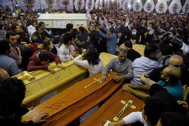 Relatives of victims react to coffins arriving to the Coptic church that was bombed on Sunday in Tanta, Egypt, April 9, 2017. REUTERS/Mohamed Abd El Ghany