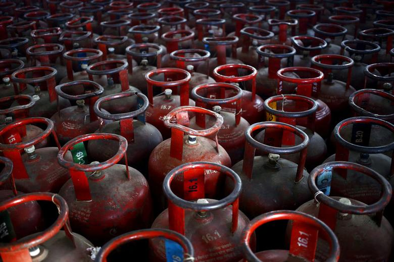 FILE PHOTO: Empty Liquefied Petroleum Gas (LPG) cylinders are seen at a gas distribution centre in Dujana village, India, October 7, 2015.   REUTERS/Anindito Mukherjee/File Photo