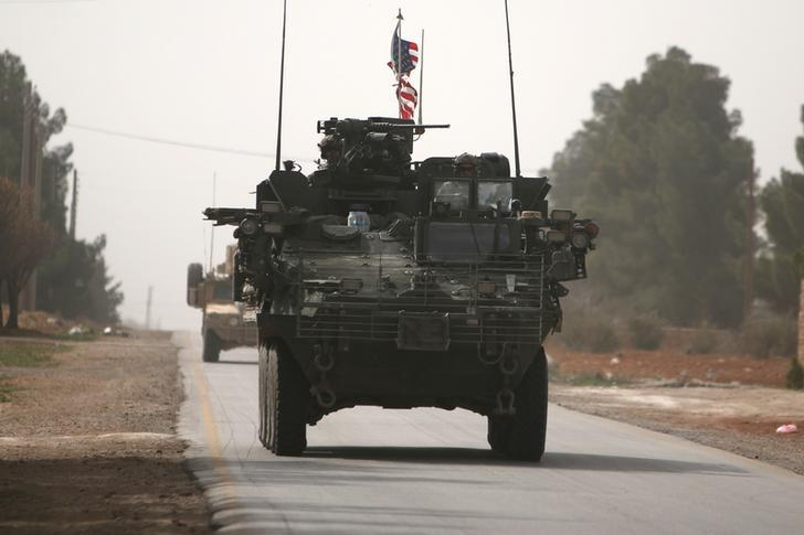 American army vehicles drive north of Manbij city, in Aleppo Governorate, Syria March 9, 2017. REUTERS/Rodi Said
