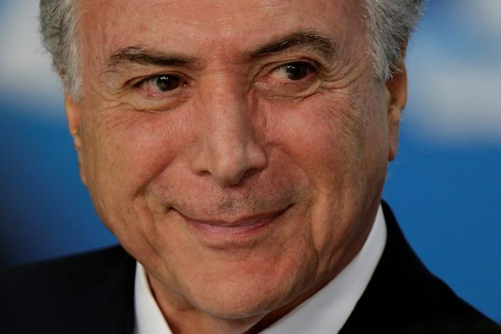 Brazil's President Michel Temer reacts during a ceremony of Sanction of the Law of Revision of the Regulatory Framework of the Broadcasting at the Planalto Palace in Brasilia, Brazil March 28, 2017. REUTERS/Ueslei Marcelino