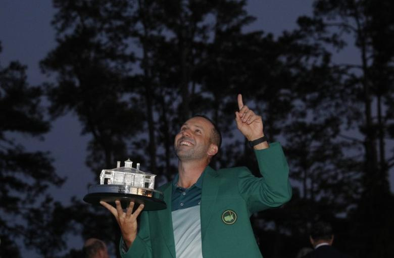 Sergio Garcia of Spain points to the sky as he holds the Masters trophy after winning the 2017 Masters golf tournament at Augusta National Golf Club in Augusta, Georgia, U.S., April 9, 2017. REUTERS/Mike Segar