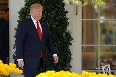 U.S. President Donald Trump arrives for the swearing in ceremony of Judge Neil Gorsuch as an Associate Supreme Court Justice in the Rose Garden of the White House in Washington, U.S., April 10, 2017.    REUTERS/Joshua Roberts