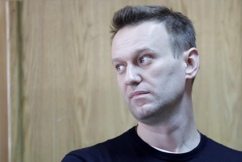 FILE PHOTO: Russian opposition leader Alexei Navalny attends a hearing after being detained at the protest against corruption and demanding the resignation of Prime Minister Dmitry Medvedev, at the Tverskoi court in Moscow, Russia March 27, 2017. REUTERS/Tatyana Makeyeva/File PhotoFOR EDITORIAL USE ONLY. NO RESALES. NO ARCHIVES