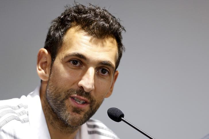 A.C. Milan soccer player Diego Lopez Rodriguez attends a news conference ahead of a friendly match against Real Madrid in Shanghai, July 29, 2015. REUTERS/Aly Song/File Photo