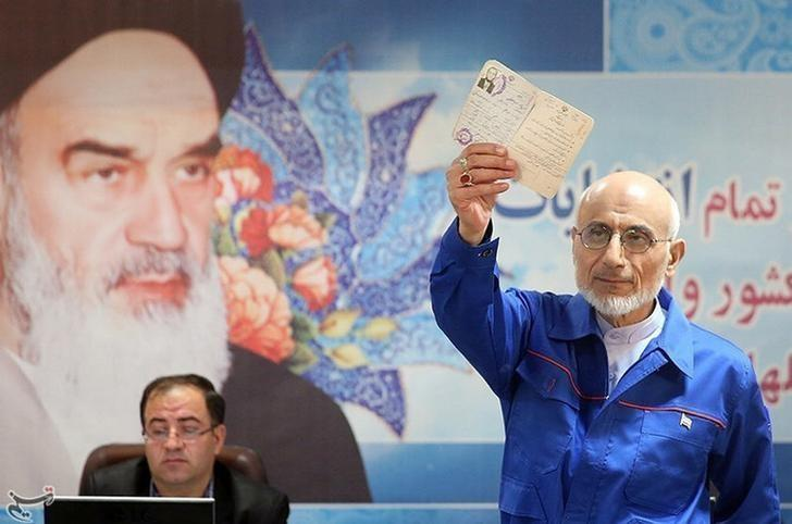 Mostafa Mirsalim, Iranian former minister of culture, holds his document as he registers his candidacy for presidential elections at the Interior Ministry in central Tehran, Iran, April 11, 2017. Tasnim News Agency/Handout via REUTERS/Files