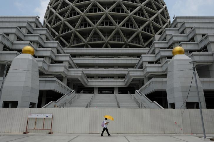 A woman walks inside Dhammakaya temple in Pathum Thani province, Thailand, March 9, 2017. Picture taken March 9, 2017. REUTERS/Athit Perawongmetha