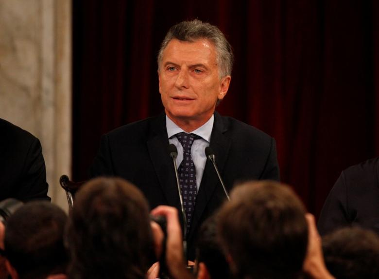 FILE PHOTO: Photographers take pictures of Argentina's President Mauricio Macri during the opening of a new legislative session in Buenos Aires, Argentina March 1, 2017. REUTERS/Martin Acosta