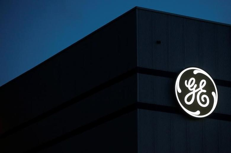FILE PHOTO: The General Electric logo is pictured on the General Electric offshore wind turbine plant in Montoir-de-Bretagne, near Saint-Nazaire, western France, November 21, 2016. REUTERS/Stephane Mahe
