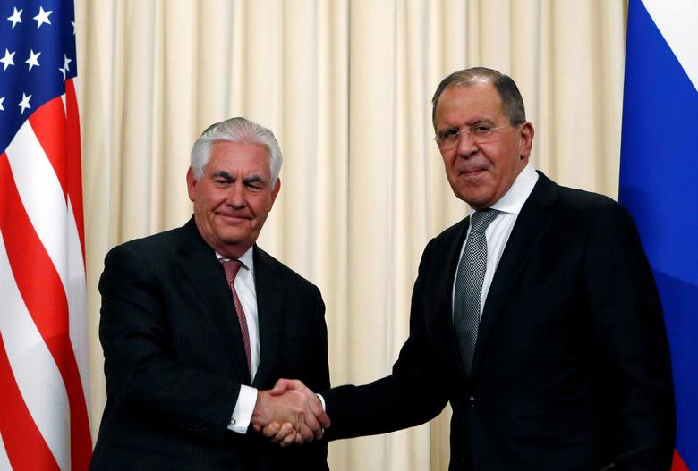 Russian Foreign Minister Sergei Lavrov shakes hands with U.S. Secretary of State Rex Tillerson during a news conference following their talks in Moscow, Russia, April 12, 2017. REUTERS/Sergei Karpukhin