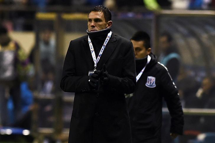 Gustavo Poyet, coach of Shanghai Shenhua, stands near the field during the AFC Champions League 2017 play-off match between Shanghai Shenhua and Brisbane Roar in Shanghai, China, February 8, 2017. REUTERS/Stringer/Files