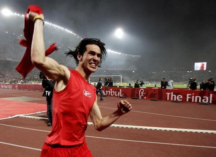 FILE PHOTO: Liverpool's Spanish player Luis Garcia celebrates winning the Champions League final soccer match against AC Milan in Istanbul  May 25, 2005.    REUTERS/Jerry Lampen/Files