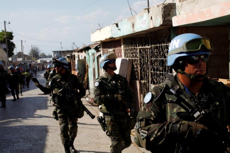 U.N. peacekeepers patrol the neighborhood of Cite Soleil together with Haitian national police officers and members of UNPOL (United Nations Police) in Port-au-Prince, Haiti, March 3, 2017. Picture taken March 3, 2017. REUTERS/Andres Martinez Casares