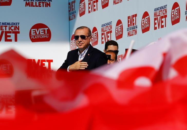 Turkish President Tayyip Erdogan greets his supporters during a rally for the upcoming referendum, in Izmir, Turkey, April 9, 2017. REUTERS/Umit Bektas