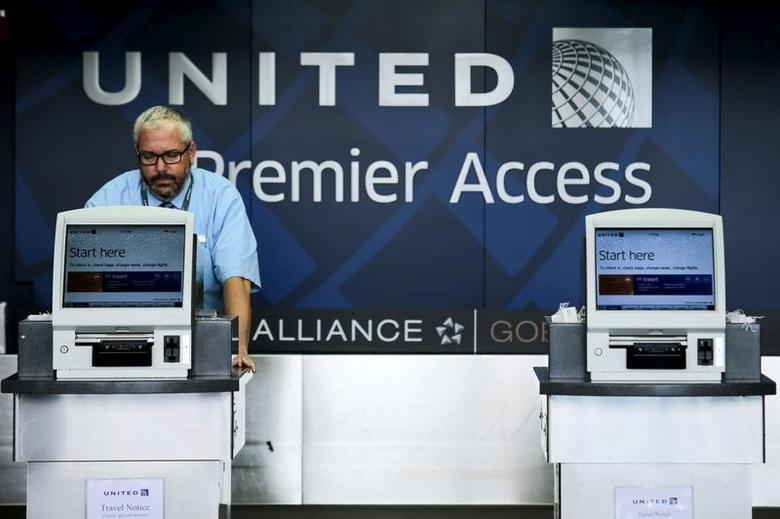 A United Airlines worker checks computers in their counters at the Newark Liberty International Airport in New Jersey, July 8, 2015.  REUTERS/Eduardo Munoz