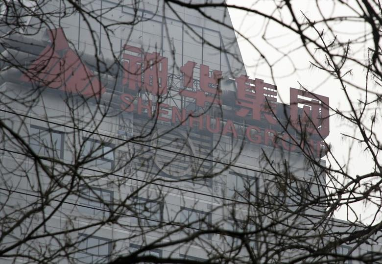 A logo of the Shenhua Group is seen atop of Shenhua Tower in Beijing March 21, 2013. To match story SHENHUA/RESULT  REUTERS/Iris Zhao