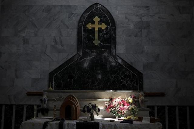An altar is seen inside a church in the town of Qaraqosh, south of Mosul, Iraq, April 12, 2017. REUTERS/Marko Djurica