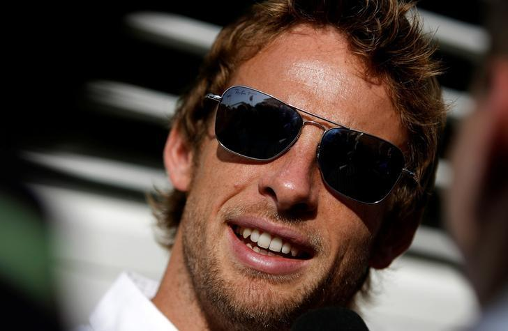 FILE PHOTO -  Brawn GP Formula One driver Jenson Button of Britain speaks to the media at the Hungaroring circuit near Budapest July 23, 2009.  REUTERS/Stoyan Nenov/File Photo