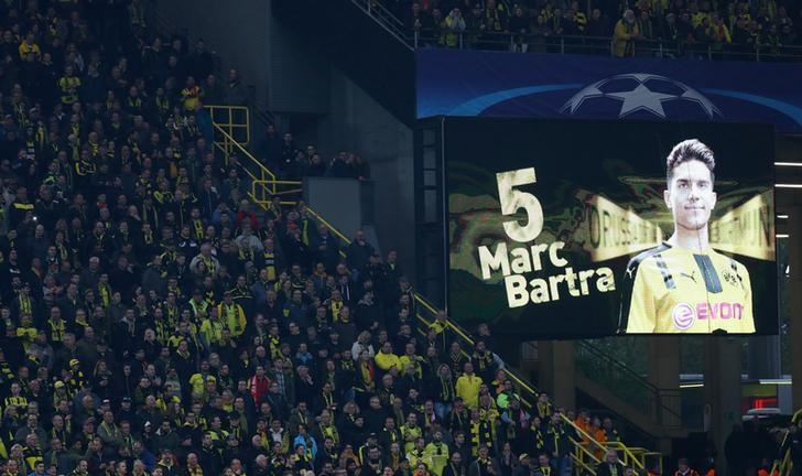 FILE PHOTO: Borussia Dortmund v AS Monaco - UEFA Champions League Quarter Final First Leg - Signal Iduna Park, Dortmund, Germany - 12/4/17 Borussia Dortmund fans look on as a message is displayed in support of Borussia Dortmund's Marc Bartra  Reuters / Kai Pfaffenbach/File Photo