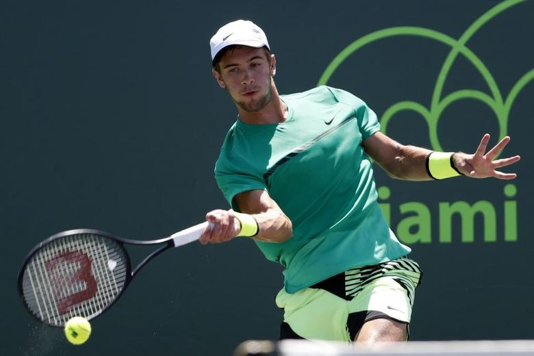 Mar 27, 2017; Miami, FL, USA; Borna Coric of Croatia hits a forehand against Adrian Mannarino of France (not pictured) on day seven of the 2017 Miami Open at Crandon Park Tennis Center. Mandatory Credit: Geoff Burke-USA TODAY Sports