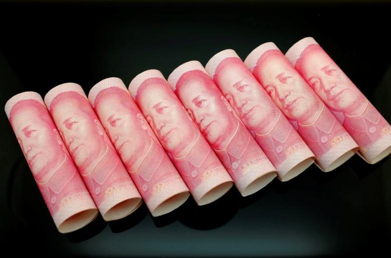 FILE PHOTO -  100 Yuan notes are seen in this illustration picture in Beijing November 5, 2013. REUTERS/Jason Lee/File Photo