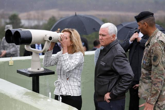 U.S. Vice President Mike Pence stands next to his daughter looking toward the north through a pair of binocular from an observation post inside the demilitarized zone separating the two Koreas, in Paju, South Korea, April 17, 2017.  REUTERS/Kim Hong-Ji